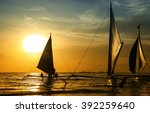 silhouettes of sailing boats at ... | Shutterstock . vector #392259640