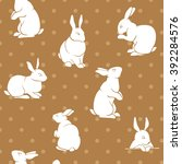 brown rabbit silhouettes logo ... | Shutterstock .eps vector #392284576