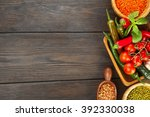wooden bowls of various lentils ... | Shutterstock . vector #392330038