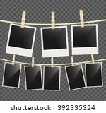 photo empty frames on rope with ... | Shutterstock .eps vector #392335324