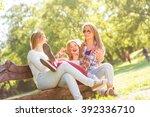 group of three teenage girls... | Shutterstock . vector #392336710