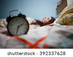 woman with insomnia touching... | Shutterstock . vector #392337628