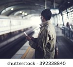 businessman waiting train... | Shutterstock . vector #392338840