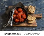 Meatballs In A Pan On Rustic...