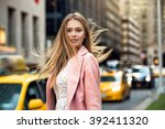 portrait of blonde girl with... | Shutterstock . vector #392411320