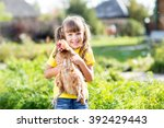 child little girl with hen...   Shutterstock . vector #392429443