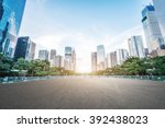 empty asphalt road and modern... | Shutterstock . vector #392438023