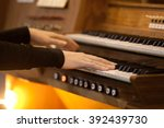Small photo of Hands of a woman playing the organ