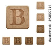 set of carved wooden bold font...