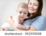 picture of happy mother with... | Shutterstock . vector #392555038