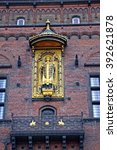Small photo of Golden Statue Of Bishop Absalon, the founder of Copenhagen, on the wall of Copenhagen City Hall. Denmark. January 05, 2013