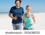 couple exercising at beach.... | Shutterstock . vector #392638033