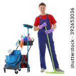 young janitor with cleaner cart ... | Shutterstock . vector #392653036