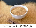 dry amaranth grains in white...