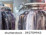 clean clothes on hangers in the ... | Shutterstock . vector #392709943
