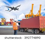 dock worker talking with radio... | Shutterstock . vector #392774890