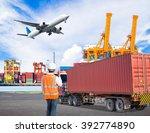 dock worker talking with radio... | Shutterstock . vector #392774890