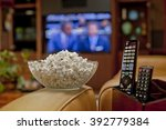 ready to watch the game on tv... | Shutterstock . vector #392779384