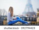 beautiful young girl outdoors...   Shutterstock . vector #392794423