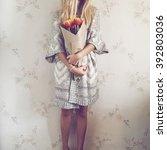girl in fashion ethnic coat... | Shutterstock . vector #392803036