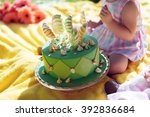 cupcake with green icing and... | Shutterstock . vector #392836684