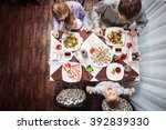 family of four having meal at a ... | Shutterstock . vector #392839330