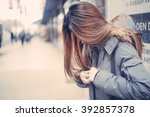 woman on the street in film... | Shutterstock . vector #392857378