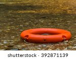 orange swim ring for fun at the ... | Shutterstock . vector #392871139