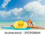 girl lies on the white sand on... | Shutterstock . vector #392908864