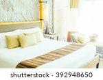 beautiful pillow on luxury bed... | Shutterstock . vector #392948650
