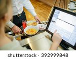 man paying with money in...   Shutterstock . vector #392999848