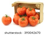 fresh tomatoes in a wooden... | Shutterstock . vector #393042670