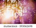 beautiful girl in a field of... | Shutterstock . vector #393062698