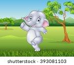 Cartoon Happy Elephant In The...