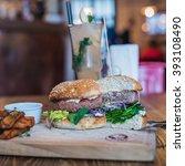 beef burger cut in half on... | Shutterstock . vector #393108490