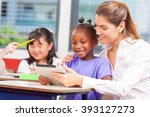 teacher with multi ethnic... | Shutterstock . vector #393127273