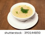 soup with spice on a wood... | Shutterstock . vector #393144850