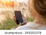 Closeup Woman Using Phone...