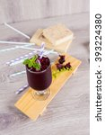 Small photo of Fresh roselle juice (healthy drink) on wooden background.