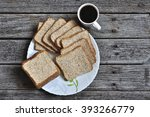 sliced bread and cup of coffee... | Shutterstock . vector #393266779