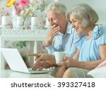 happy senior couple with laptop | Shutterstock . vector #393327418