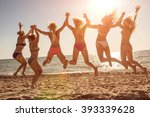 six girls  jumping on beach at... | Shutterstock . vector #393339628