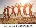 six girls  jumping on beach at... | Shutterstock . vector #393339628