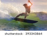 surfing a wave  bali  indonesia  | Shutterstock . vector #393343864