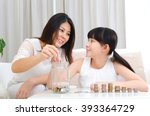 asian girl and mother putting...   Shutterstock . vector #393364729