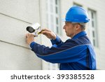 mature male technician... | Shutterstock . vector #393385528