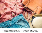 Stock photo clothing for women placed on a wooden floor 393445996