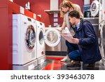young couple choosing washing... | Shutterstock . vector #393463078