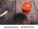 Small photo of Energy booster; strawberry orange lemon and passion fruit smoothie on a working table. Selective focus at smoothie glass.