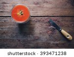 Small photo of Energy booster; strawberry orange lemon and passion fruit smoothie on a working table. Selective focus at smoothie glass with copy space